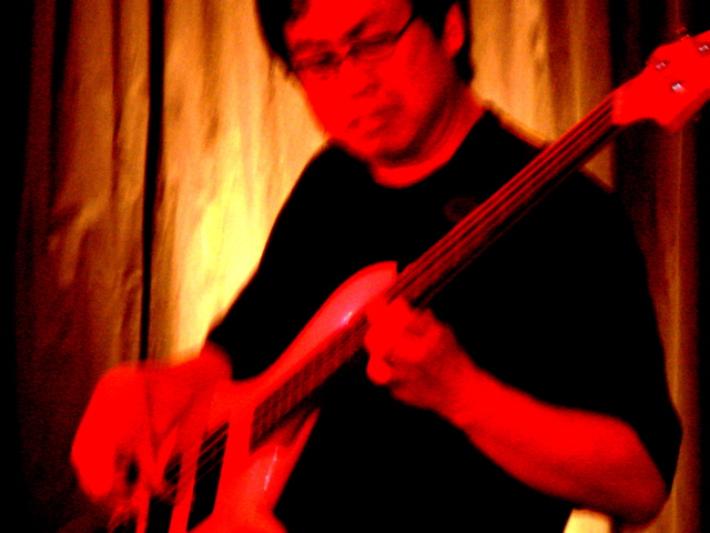 Bassist Eddie Tsuru with the Dave Walker Band
