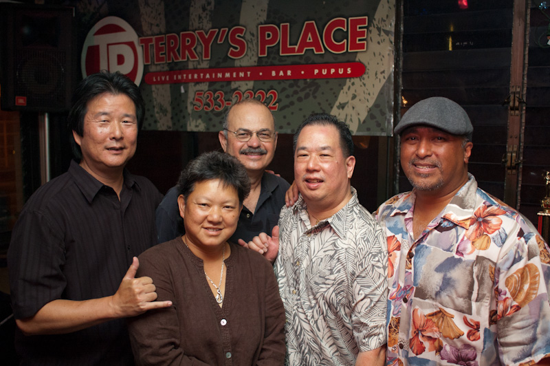 (From L to R) Brad Choi, drums; Terry Kakazu, owner of Terry's Place; Tim Hurley, bass; Ron Yuen, guitar; Peter Paul, guitar.