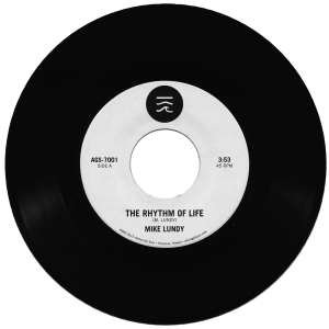 "AGS-7001 - Mike Lundy ""The Rhythm Of Life"" / ""Tropic Lightning"""