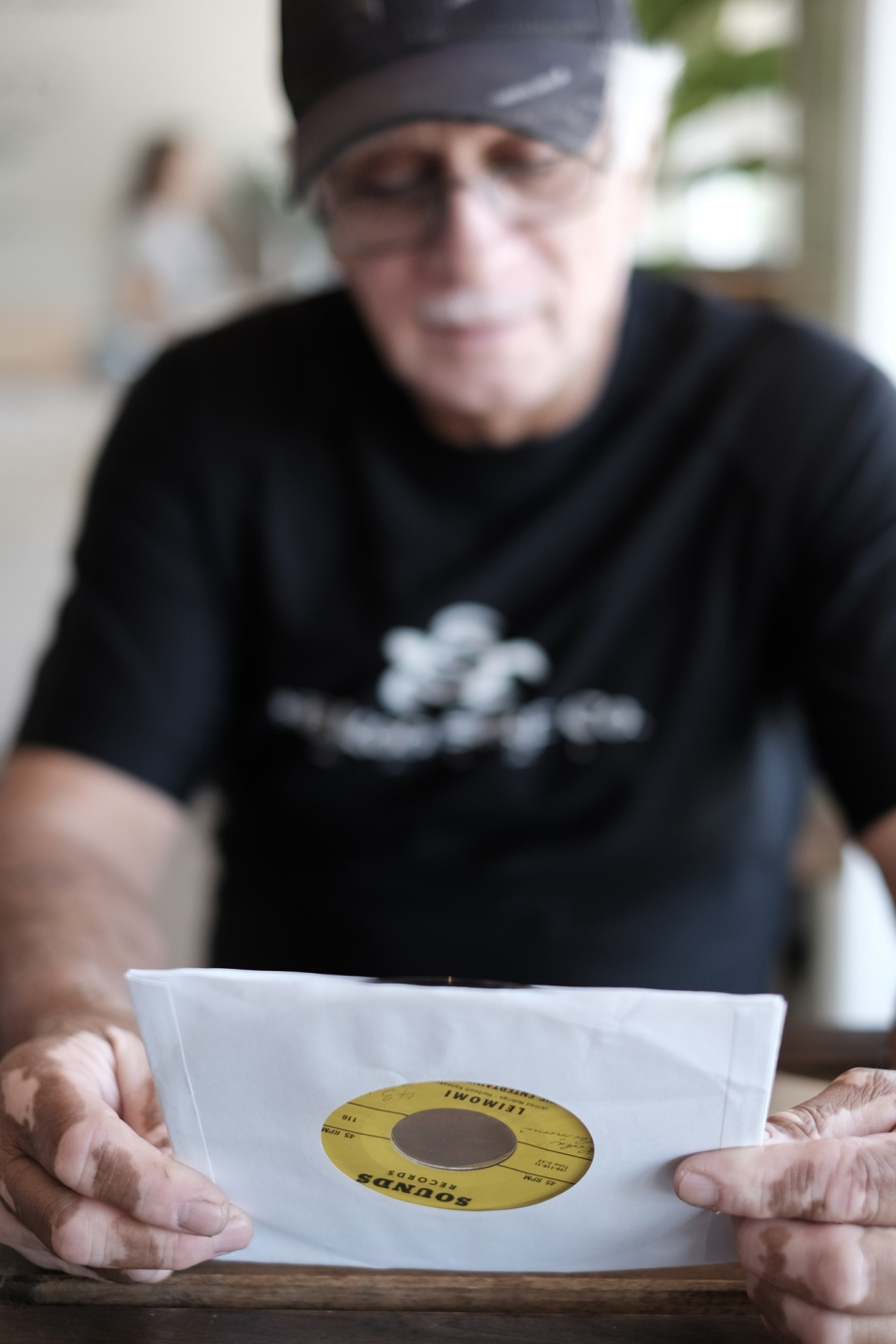 """Al Nobriga with a copy of """"Leimomi"""" by The Entertainers Five. Nobriga wrote the song for his daughter."""