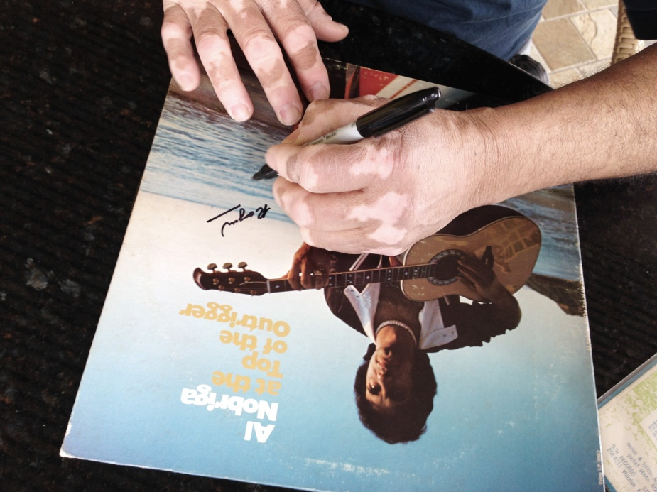 """Al Nobriga signing Roger Bong's copy of """"At The Top Of The Outrigger"""" LP"""